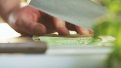 Cutting Cucumber Seen From the Side Stock Footage