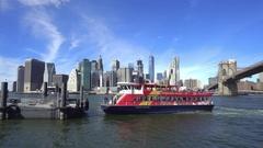 Manhattan skylines with sightseeing boat. New York, Brooklyn bridge Stock Footage