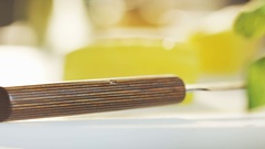Cutting Japanese Radish Seen From the Side Stock Footage