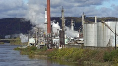 Riverside smoking oil refinery plant landscape - United States Stock Footage