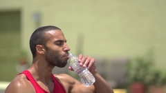 A man pouring water over his head and resting after a intense workout, super slo Stock Footage