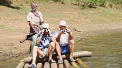 Caucasian Tourists Old Men Sit on Raft Photo against Park Stock Footage