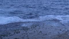 Waves wash over sea rocks Stock Footage