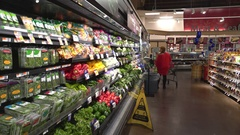 Woman shopping in grocery store, supermarket. Food on the shelf - United States Stock Footage