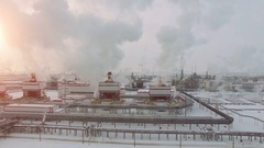 Aerial view of Oil Power Plant. Cold winter day. Sun shining Stock Footage