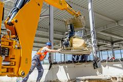 Moving power trowel machine with excavator on a new job site Kuvituskuvat