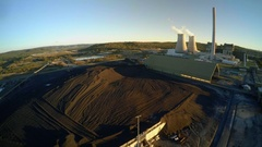 Coal power station: aerial tilt coal mine to electricity plant in Australia Stock Footage