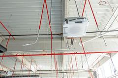 Flexible air conditioning and fire fighting system is placed on the ceiling Stock Photos