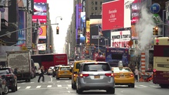 New York city traffic, street view with steam and advertising - Manhattan Stock Footage