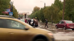 Kirov street in the fall of people jumping in puddles Stock Footage