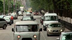 Kirov summer Oktyabrsky prospect going cars Stock Footage
