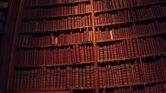 Big collection of old uncognizable books. 4K pan shot Stock Footage