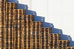 Wooden pallet overlap in warehouse Stock Photos