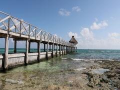 Mexico Caribbean Ocean pier rocky beach 60fps DCI 4K Stock Footage