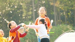 Shanghai,China-\Chinese kids playing in the garden.Slow motion Stock Footage