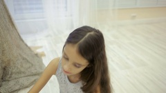 Little girl is painted before a mirror her mother's makeup Stock Footage