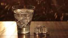 A glass of mineral water on a wooden table Stock Footage