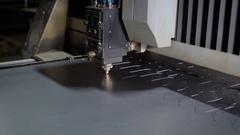 High precision CNC laser cutting metal sheet. Modern technologies allow to Stock Footage