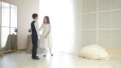 Boy in suit dancing break dance in front of a girl Arkistovideo