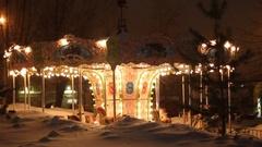 Merry-go-round carousel at winter night Arkistovideo