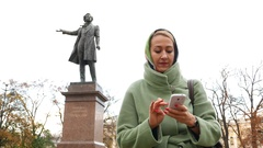 Woman prepare and take selfie against famous poet sculpture Stock Footage