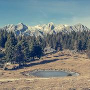 Frozen mountain lake at autumn meadow Stock Photos