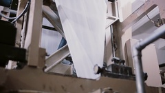Paper in a printing machine. Printing establishment detail on production line Stock Footage
