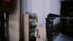 Paper in a printing detail on production line with sound. Process of printing at Stock Footage