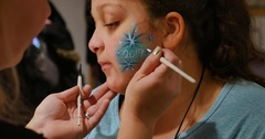 Little Girl Gets Her Face Painted at a Carnival or Craft Show	 	 Stock Footage