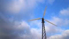 Wind power generator on blue sky. Stock Footage
