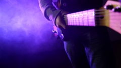 This is a close up shot of a man playing a guitar Stock Footage