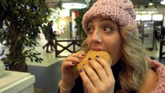 Smiling Woman Blonde Eating Meals Burger in Mall Fast Food Cafe Stock Footage