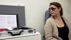 Female patient is instructed to read the Optometrist Test Chart Stock Footage