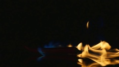 Hot pepper in fire arms. hot pepper in flames on a black background. Stock Footage