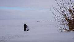 Children come back from the lake covered with ice. Stock Footage