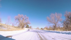Driving through winter landscape in Cherry Creek State Park, Colorado. Stock Footage