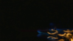 Hot pepper in fire arms. hot pepper in flames on a black background Stock Footage