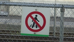 No crossing train tracks signage at a train station Stock Footage