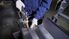 Work using mechanized hand for spot welding of metal izdeliy.Muzhchina working Stock Footage