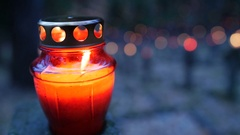 Cemetery at night with colorful candles for All Saints Day. All Saints' Day is a Stock Footage