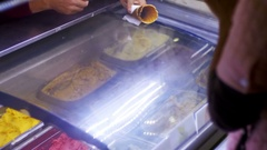 Showcase with Ice Cream Sold by Weight Stock Footage