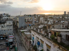 Timelaps bird's-eye view of dilapidated streets in downtown at Havana dawn sun Stock Footage