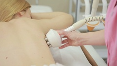 Hardware cosmetology. woman getting rf lifting procedure in a beauty parlour. Stock Footage
