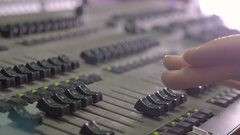 Men's hand on the mixing console Stock Footage