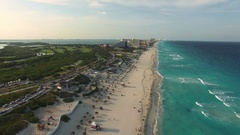 Aerial footage of Cancun beach. Drone flying above shore line with hotels Stock Footage