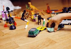 Children playing toys on floor at home, little hand in mess, free education Stock Photos