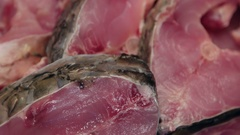 Slices of raw carp on a wooden table ready to be cooked Stock Footage