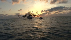 SHRIMP BOAT AND SMALL BOAT AT EARLY MORNING SUN Stock Footage