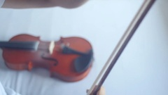 Violin playing [covering the bow in rosin] Stock Footage