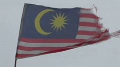 Old battered Malaysia flag in the breeze Stock Footage